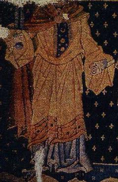 Fortitudo auf dem Quedlinburger Knüpfteppich um 1200 - weite Cotte mit breiter Verzierung am unteren Saum